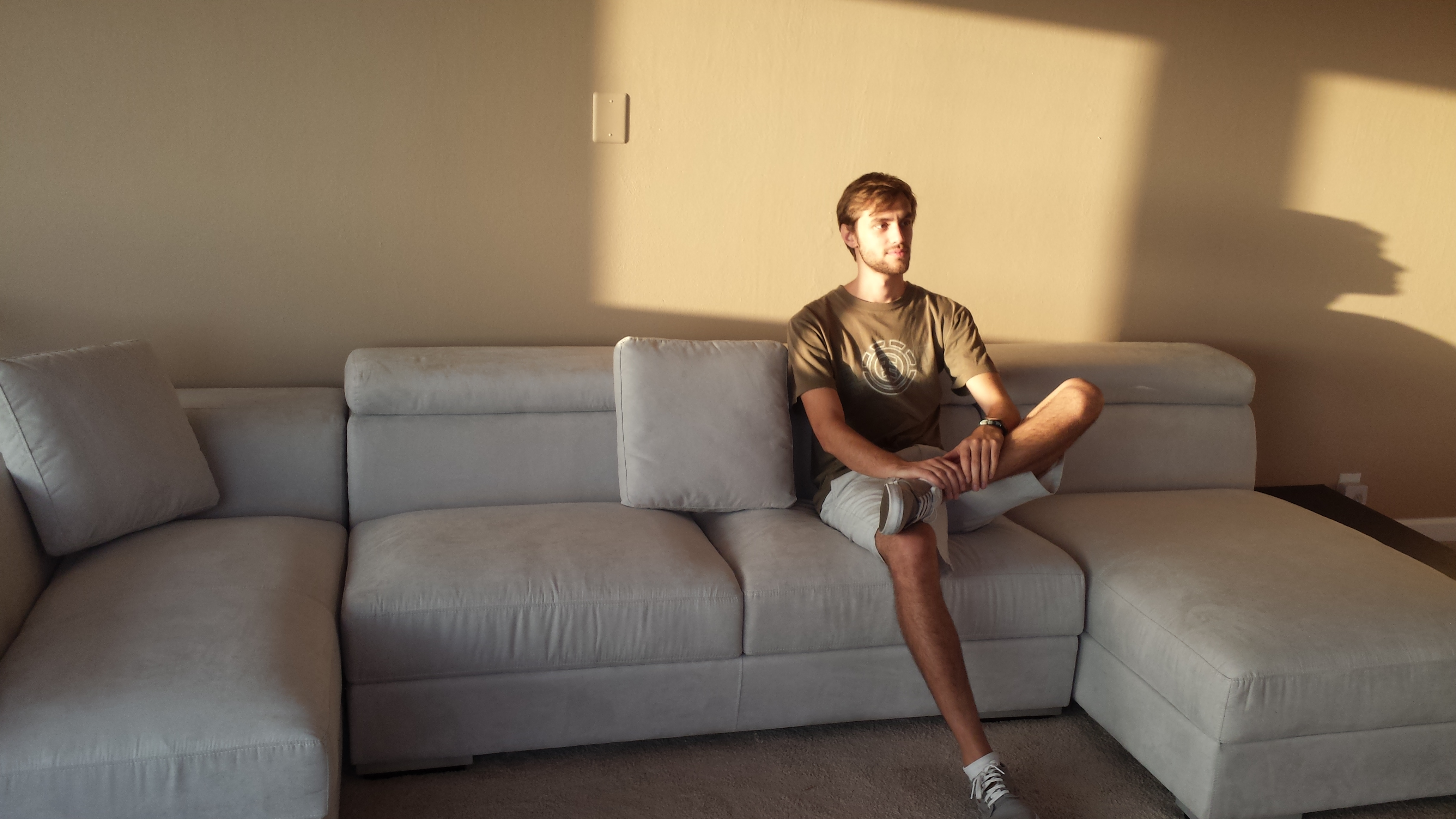 Here is Andrew Belanich sitting on the Milanou0027s Light Grey Modern Microfiber Sectional. The Belanich family recently purchased a home with an Incredible ... : andrew sectional sofa - Sectionals, Sofas & Couches